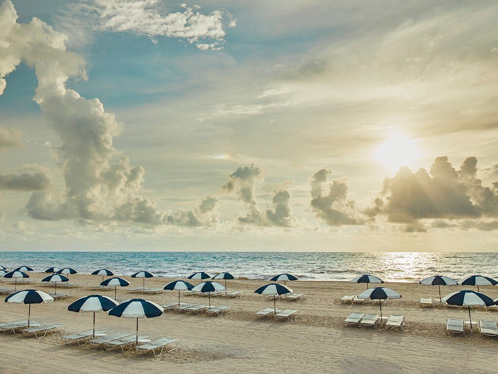 The Breakers luxury hotel in palm beaches view over beach with umbrellas